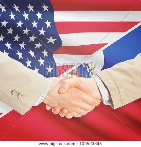 Businessmen Handshake - United States And Haiti