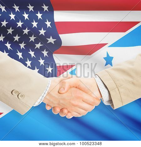 Businessmen Handshake - United States And Honduras
