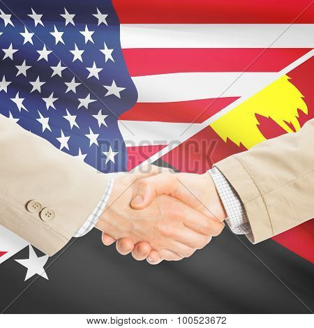 Businessmen Handshake - United States And Papua New Guinea