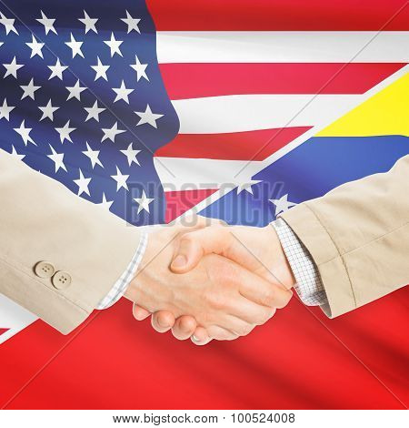 Businessmen Handshake - United States And Venezuela
