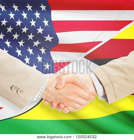 Businessmen Handshake - United States And Zimbabwe