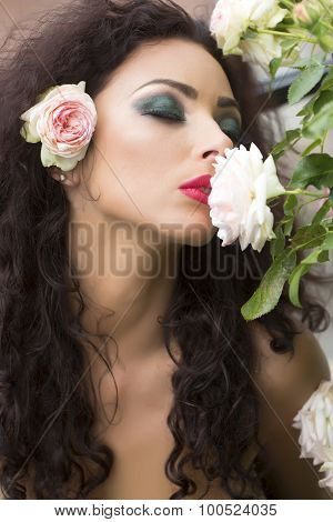 Pretty Young Woman With Flower In Hair