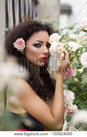 Sexy Young Woman Posing Near Rose Bush