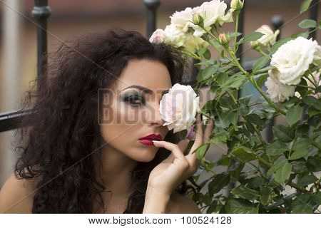 Portrait Of Glamour Woman Near Flowers