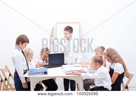 The group of teenagers sitting in a business meeting