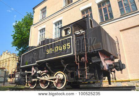 KIEV, UKRAINE - SEP 2, 2015:  The monument of Soviet steam locomotive   near Technical History Museum  of National Polytechnic University on September 2, 2015 in Kiev, Ukraine