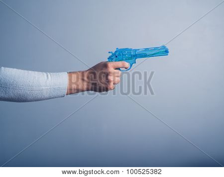 Hand With Blue Water Pistol