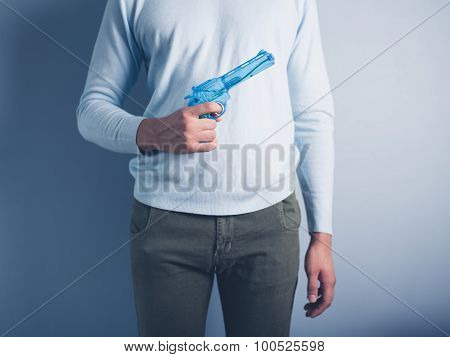Young Man Posing With Water Pistol