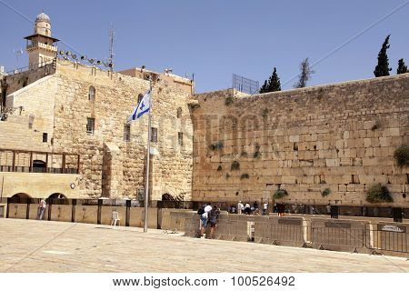 People Visiting And Praying At The Western Wall In Jerusalem, Israel