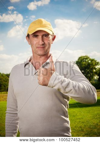 smiling man standing outdoors positive gesture
