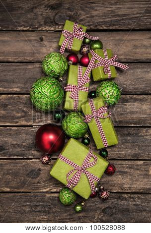 Apple green christmas presents with a red white check ribbon on old wooden bard for decoration.