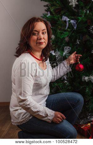 Nice woman decorating  Christmas tree