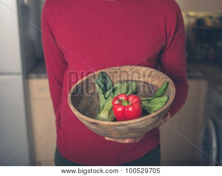 Man In Kitchen With Vegetables