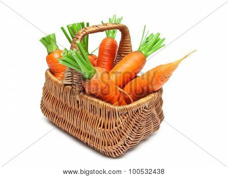 Basket With Ripe Carrots Isolated On White Background