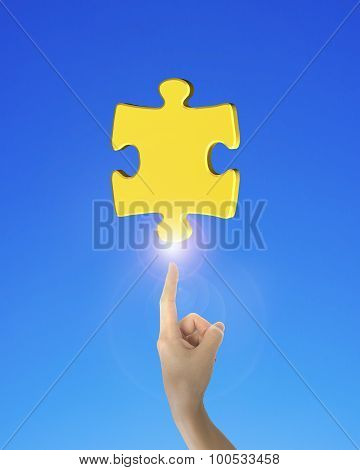 Human Finger Pointing At Jigsaw Puzzle Piece