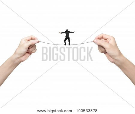 Businessman Balancing On Tightrope With Woman Two Hands Holding