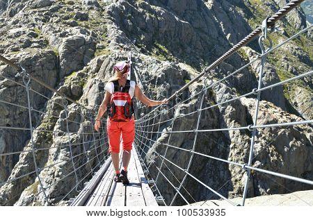 Traveler on theTrift bridge. Switzerland