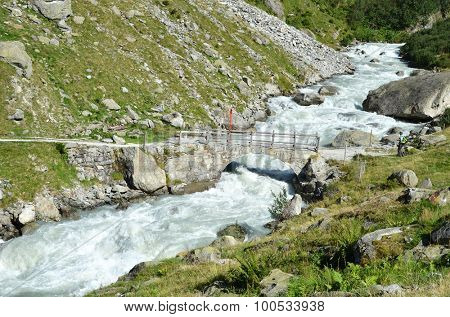 Mountain river coming from Trift glacier. Switzerland