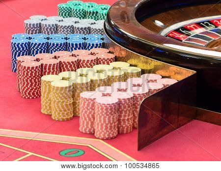 Casino American Roulette gambling table with a wheel and  playing chips on the layout