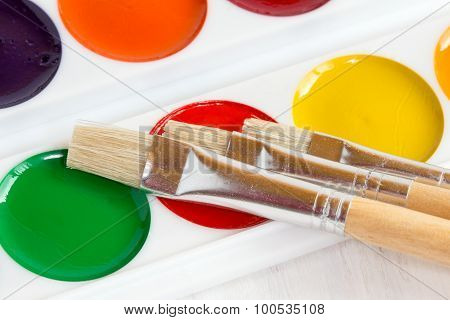 Palette Of Watercolor Paints With Paint Brushes