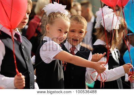 Orel, Russia - September 1, 2015: Young Gilr And Boy In School Uniform With Baloons