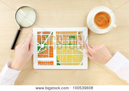 Woman using tablet with map gps navigation application, top view