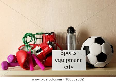 Sport goods for sale, on light wall background