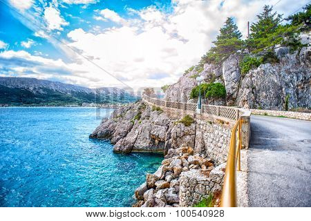 Beautiful Adriatic Sea Coastline With Dramatic Sky And Sunlight. Rocky Coastline With Ocean Waves