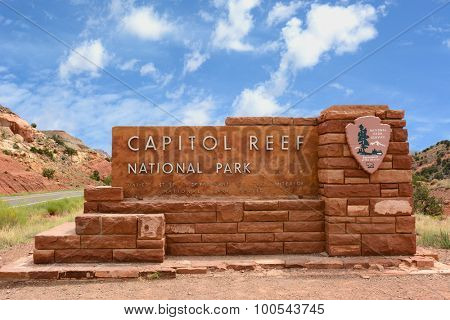 Capitol Reef National Park sign, Utah. Capitol Reef features sandstone formations, cliffs and canyons, and a 100-mile long bulge in the earth's crust called the Waterpocket Fold.