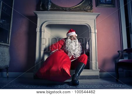 Santa Claus popping out of the chimney