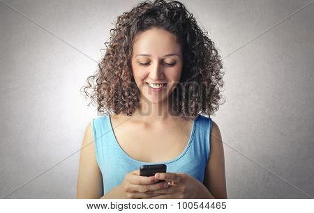 Young girl using her smartphone