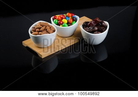 Almond, Chocolate And Date On A Background