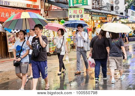 Shoppers Walking Around  Danshui Old Street And Waterfront