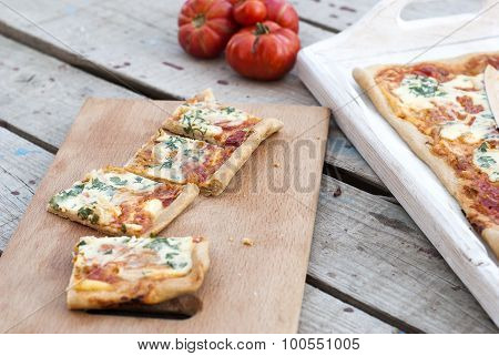 Thin Pizza With Tomato, Grated Cheese And Herbs