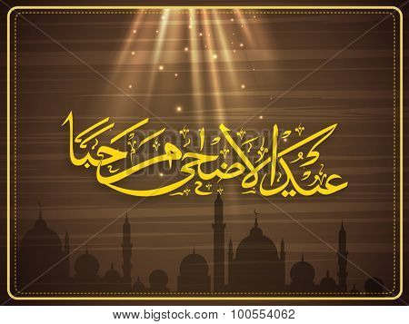 Creative Arabic Islamic calligraphy of text Eid-Ul-Adha Marhaba in spotlight on Mosque silhouetted stylish background for Muslim community festival celebration.