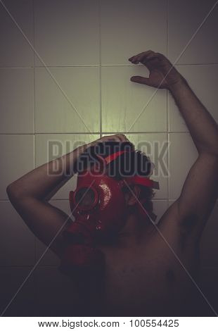 Frustration, desperate man, anguish and suffering with red gas mask