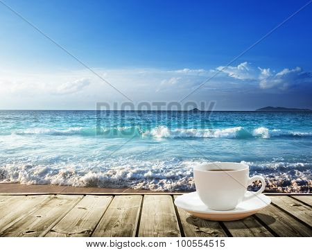 sea and cup of coffee