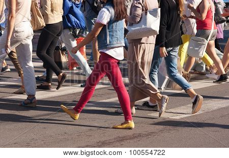 Feet Of The Pedestrians Crossing On City Street
