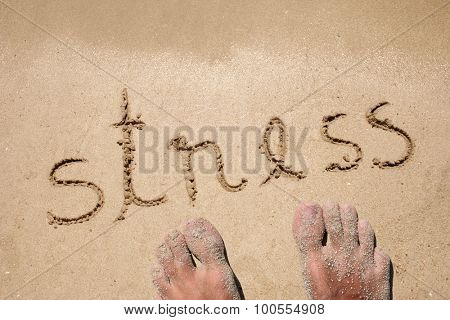 Concept or conceptual stress handwritten in sand for natural, symbol, tourism or conceptual designs with feet