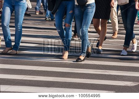 Feet Of Pedestrians Walking On The Crosswalk