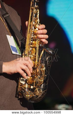Hands Of Saxophonist In Concert