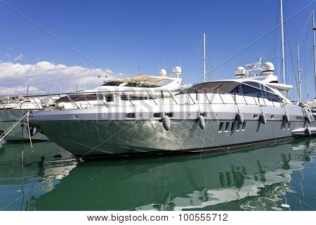 Luxury super yachts mooring in a harbor