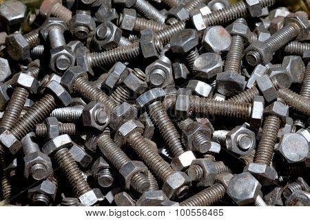 Closeup Of Rusted Old Bolts In Wooden Box.