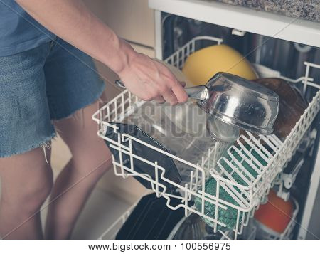 Woman Loading Dish Washer