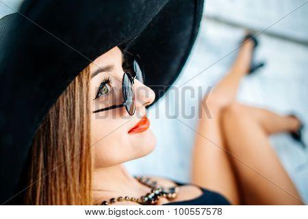 Pretty Young Girl Relaxing Outdoor In Black Swimwear