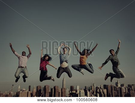 Cheerful People Jumping Friendship Happiness City Concept