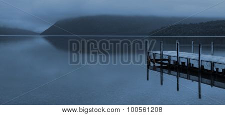 Tranquil peaceful lake with jetty New Zealand Concept