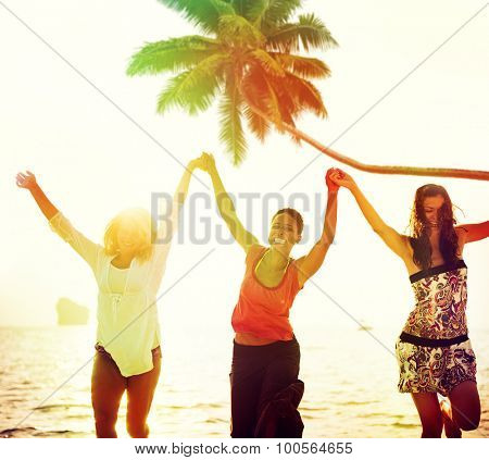 Cheerful Young Women Celebrating by the Beach Concept