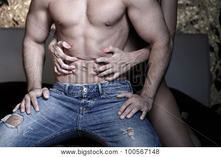 Woman Grasps Sexy Macho Mans Abs