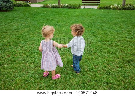 Baby Boy And Baby Girl In The Park